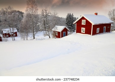 old cottages set in a snowy winter landscape, Sweden