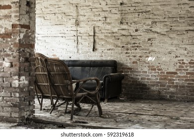 Old couch in an old brick decayed house