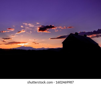 Old country barn at dawn - Williston, Vermont, USA.
