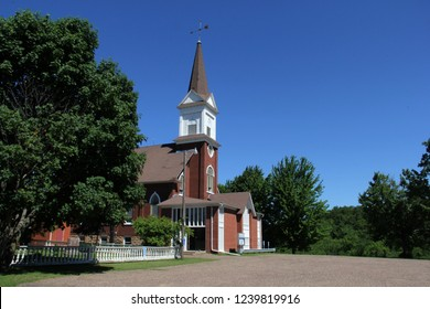 Old country church against a summer blue sky