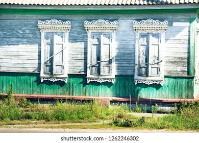 Old country house in Western Europe. Windows with protective shutters on a wooden house