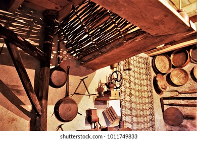 old country kitchen with hanging pans,old wooden cupboard in the kitchen of a rural house in Galicia, old wooden furniture,  typical rural cuisine of Galicia, Galician ethnographic museum,