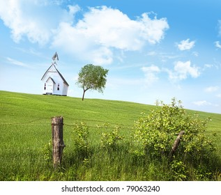 Old country school house  on a hill against a blue sky
