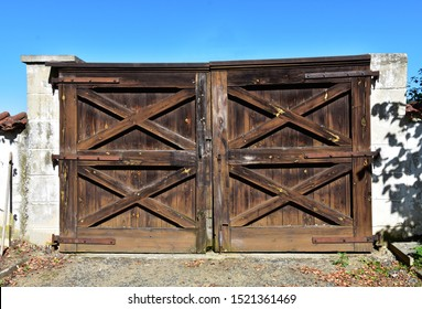 Old countryside wooden gate with with stone columns in vintage style