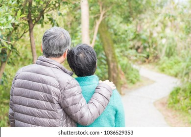 old couple back you and look somewhere