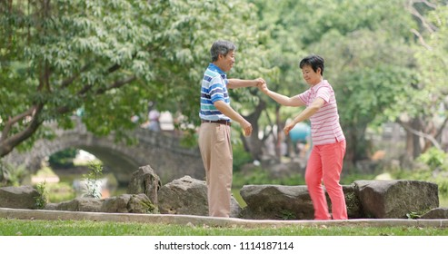 Old couple dance at outdoor park
