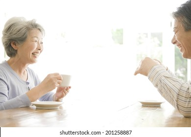 The old couple drinking coffee