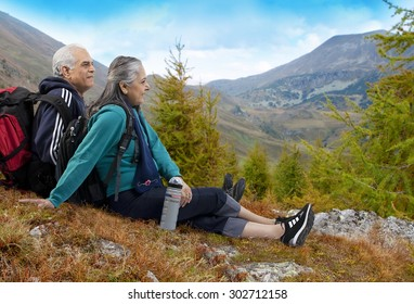 Old couple with hiking gear