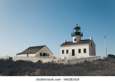 The old couple lighthouse with blue clear sky