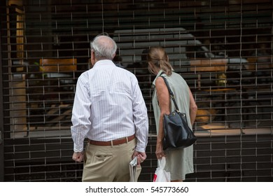 old couple looking in store window in Manhattan New York City