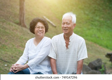Old couple outdoor. Smiling senior woman and man.