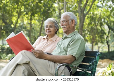 Old couple reading a document
