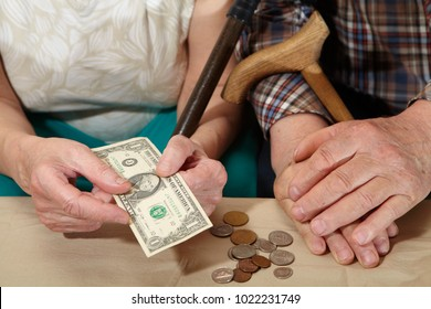 Old couple and small coin. Poverty. Senior people health care