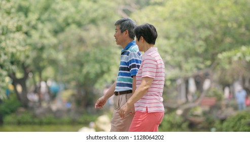 Old couple talking together at outdoor park