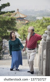 Old Couple Walking In Jing Shan Park