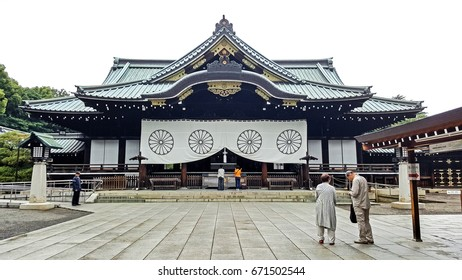 Old couples worshipping at the haiden (hall of worship) of The Yasukuni Shrine, founded by Emperor Meiji