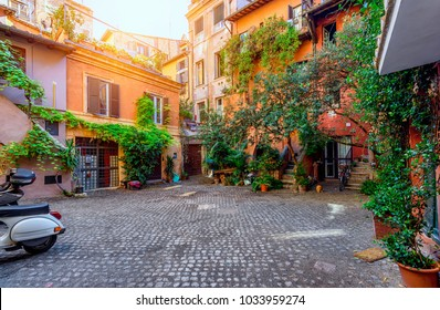 Old courtyard in Rome, Italy. Architecture and landmark of Rome. Postcard of Rome.