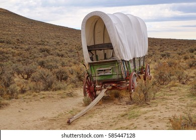 Old covered wagon on Oregon Trail. This historic site near Baker City, OR still has original ruts of the trail cut by pioneer wagons migrating to Oregon more than 150 years ago