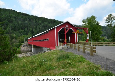 Old covered wooden bridge.I the province of Quebec.