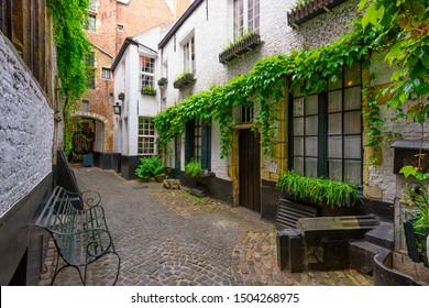 Old cozy narrow street in historic city center of Antwerpen (Antwerp), Belgium. Night cityscape of Antwerp. Architecture and landmark of Antwerpen