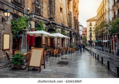 Old cozy street in Madrid, Spain. Architecture and landmark of Madrid, postcard of Madrid.