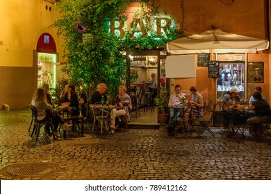 Old cozy street at night in Trastevere, Rome, Italy.  Trastevere is rione of Rome, on the west bank of the Tiber in Rome, Lazio, Italy.  Architecture and landmark of Rome