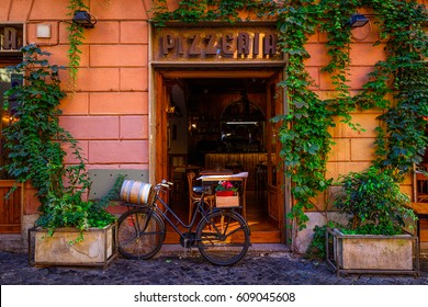 Old cozy street in Trastevere, Rome, Italy. Trastevere is rione of Rome, on the west bank of the Tiber in Rome, Lazio, Italy.  Architecture and landmark of Rome.