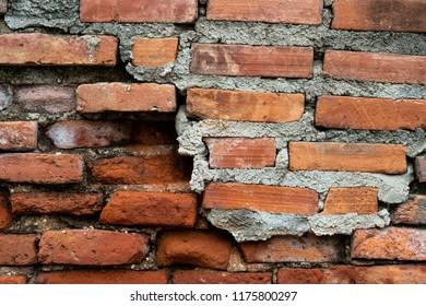 Old cracked brick wall background, pattern design element