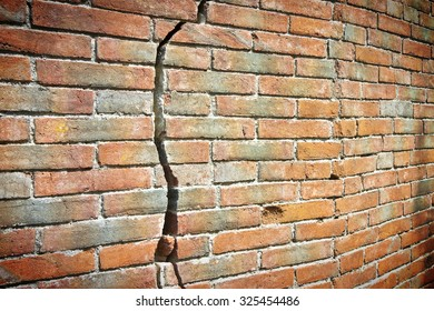 Old cracked brick wall - vignette added