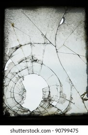 Old cracked and Broken Window in an industrial mill.