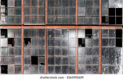 Old cracked building wall with dirty broken windows glass texture pattern
