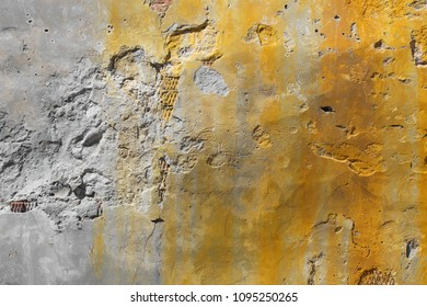 Old cracked cement wall background with rusty stains