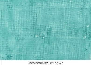 Old cracked concrete wall with net, holes, splits and stains. Texture cement background.  Turquoise, motton blue, mint and tiffani colors