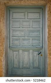 Old cracked light blue door
