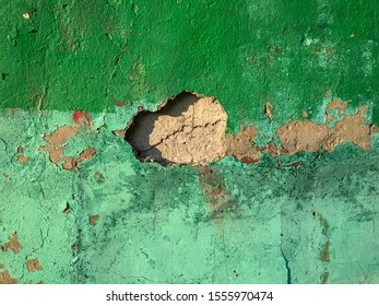 Old cracked mint wall. Painted texture background in trendy turquoise color. Banner. Trendy green and turquoise color.