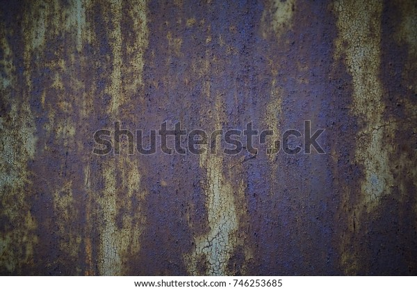 Old cracked paint on rusty metal. Abstract background.