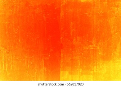 Old cracked painted orange wall, background texture