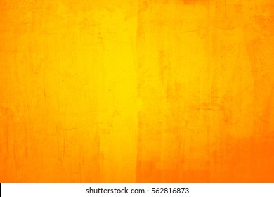 Old cracked painted yellow wall, background texture