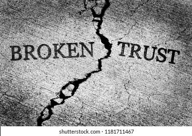 Old cracked sidewalk broken and dangerous cement lost trust untrustworthy