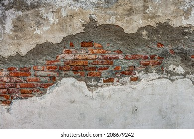 The old cracked wall of the abandoned ruins