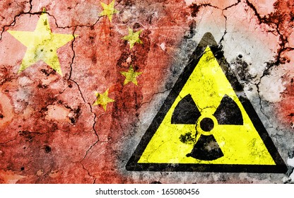 Old cracked wall with radiation warning sign and painted flag, flag of China