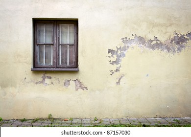 Old cracked wall with a window