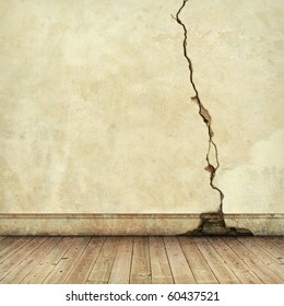 An Old Cracked Wall with wooden Floorboards
