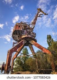 Old crane over Yanov Backwater in Chernobyl Exclusion Zone, Ukraine