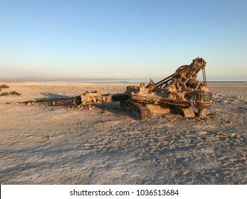 Old crane unearthed from sand at Bombay Beach California is reminiscent of apocalypse or end of the world disaster.
