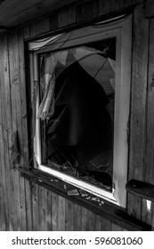 Old creepy dark abandoned destructive dirty house with broken windows
