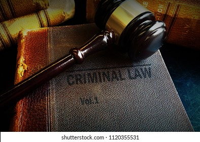 Old Criminal Law books and court gavel