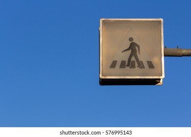 Old Crosswalk Traffic Light Sign with Blue Sky. Set as Blank Frame for Text.
