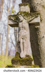 Old crucifix gravestone in old abandoned cemetery