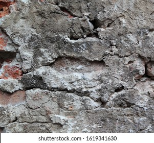 An old crumbling wall forms an irregular pattern that can be used for backgrounds.